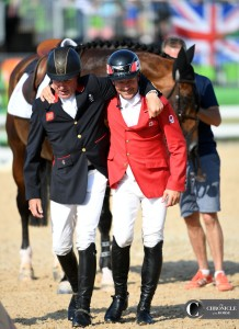 Nick Skelton and Eric Lamaze walk to the podium together at the Olympics.