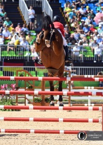 HH Azur had springs in her hind feet over this triple bar at the Olympics.