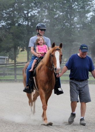 Ava's first ride on Lad.